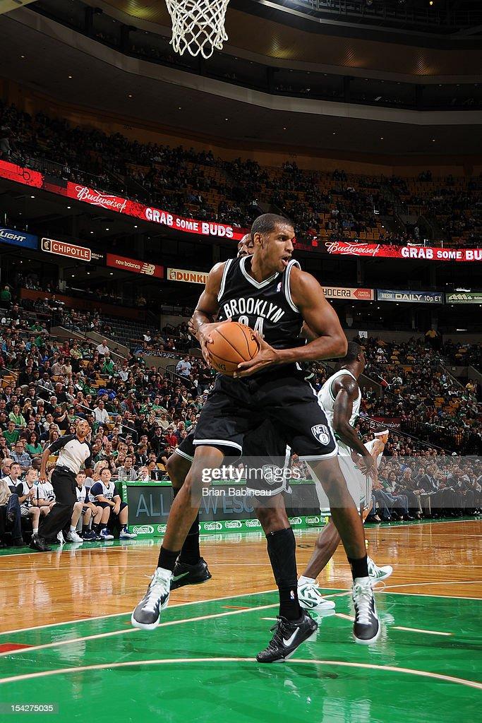 Carleton Scott #34 of the Brooklyn Nets grabs the rebound against the Boston Celtics on October 16, 2012 at the TD Garden in Boston, Massachusetts.