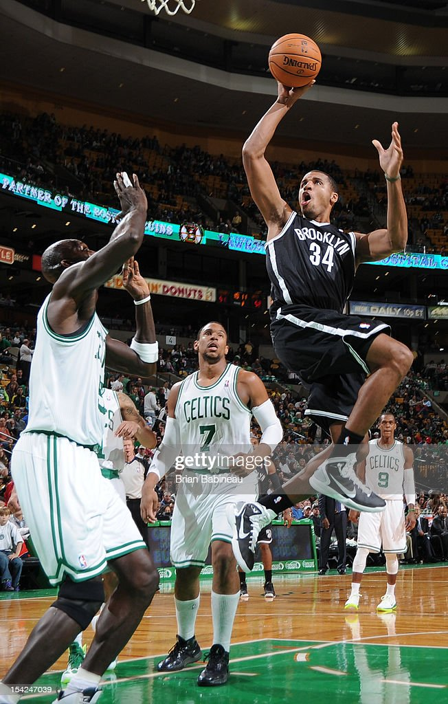 Carleton Scott #34 of the Brooklyn Nets shoots the ball against Kevin Garnett #5 of the Boston Celtics on October 16, 2012 at the TD Garden in Boston, Massachusetts.