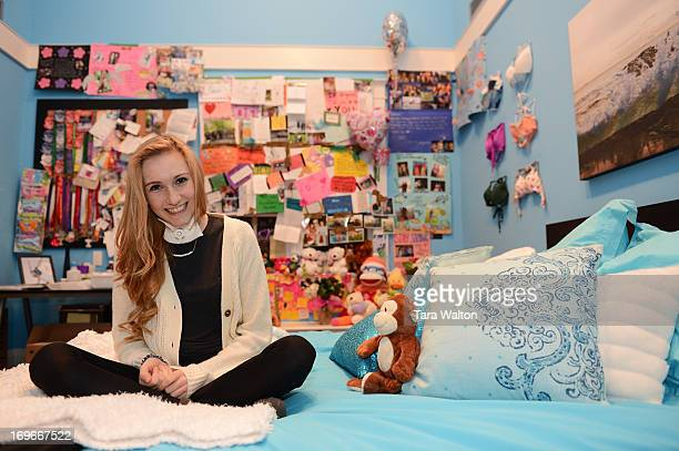 Carley Allison a 17 year old student at Bayview Glen in Toronto poses in her bedroom with her wall of support messages Monday March 4 2013 In...