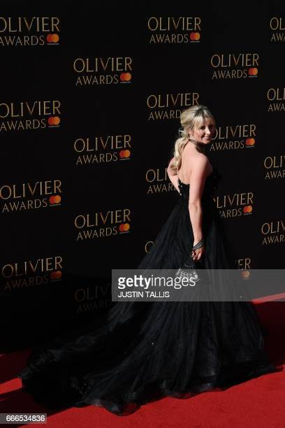 Carley Stenson poses on the red carpet upon arrival to attend the 2017 Laurence Olivier Awards in London on April 9 2017 / AFP PHOTO / JUSTIN TALLIS