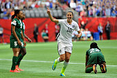 Carli Lloyd celebrates after teammate Abby Wambach of the United States scores a goal in the first half against Nigeria in the Group D match of the...