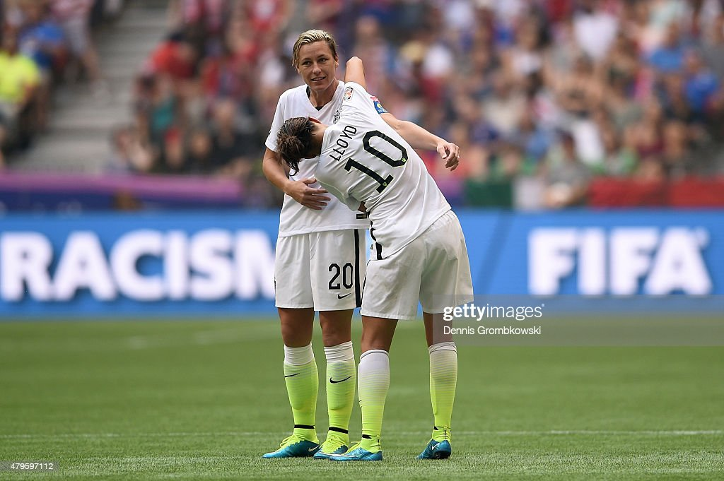 Carli Lloyd gives the captain's armband to teammate Abby Wambach of the United States in the second half against Japan in the FIFA Women's World Cup...