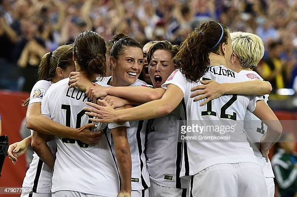 Carli Lloyd of Germany celebrates with team mates as she scores the opening goal from a penalty in the FIFA Women's World Cup 2015 SemiFinal Match at...