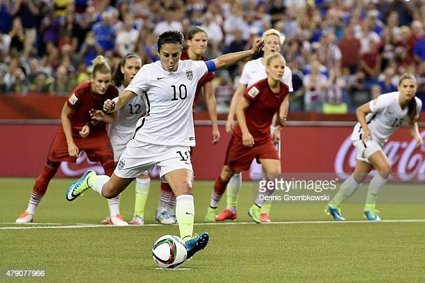 Carli Lloyd of Germany scores the opening goal from a penalty in the FIFA Women's World Cup 2015 SemiFinal Match at Olympic Stadium on June 30 2015...