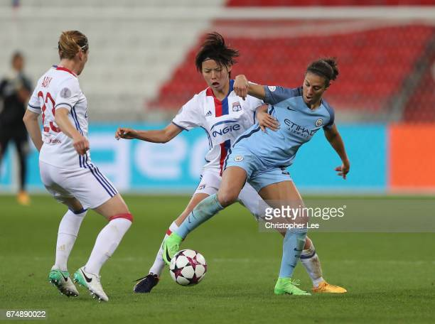 Carli Lloyd of Manchester City battles with Saki Kumagai of Olympique Lyon and Camille Abily of Olympique Lyon during the UEFA Women's Champions...