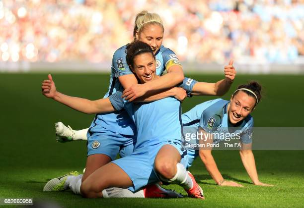 Carli Lloyd of Manchester City celebrates scoring her sides third goal with her Man City team mates during the SSE Women's FA Cup Final between...