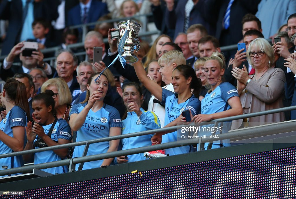 Carli Lloyd of Manchester City Women celebrates with the trophy during the SSE Women's FA Cup Final between Birmingham City Ladies and Manchester City Women at Wembley Stadium on May 13, 2017 in London, England.