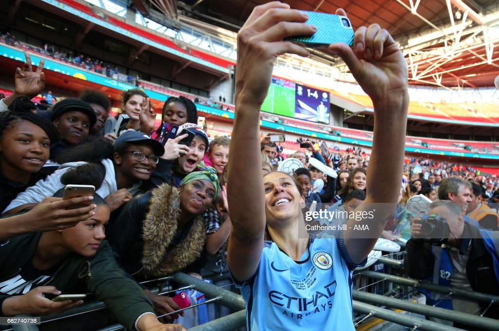 Carli Lloyd of Manchester City Women takes a selfie photo with the fans during the SSE Women's FA Cup Final between Birmingham City Ladies and Manchester City Women at Wembley Stadium on May 13, 2017 in London, England.