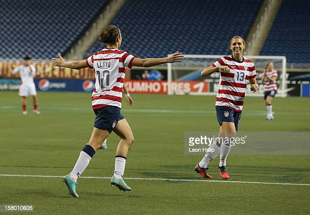 Carli Lloyd of Team USA scores a first half goal and is congratulated by her teammate Alex Morgan during the game against China at Ford Field on...
