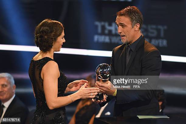 Carli Lloyd of the United States and Houston Dash accepts The Best FIFA Women's Player Award from Gabriel Batistuta of Argentina during The Best FIFA...