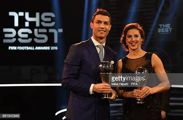 Carli Lloyd of the United States and Houston Dash and Cristiano Ronaldo of Portugal and Real Madrid pose with their The Best FIFA Player Award during...