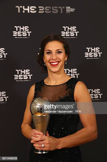 Carli Lloyd of the United States and Houston Dash poses with The Best FIFA Women's Player Award during The Best FIFA Football Awards at TPC Studio on...