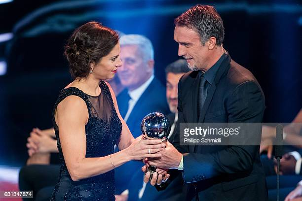 Carli Lloyd of the United States and Houston Dash receives The Best FIFA Women's Player Award from Gabriel Batistuta during The Best FIFA Football...