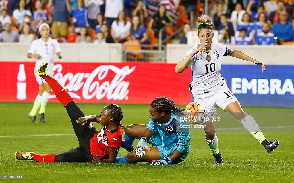 Carli Lloyd #10 of the United States battles for the ball with keeper Kimika Forbes #1 of Trinidad and Tobago during their Semifinal of the 2016 CONCACAF Women's Olympic Qualifying at BBVA Compass Stadium on February 19, 2016 in Houston, Texas.