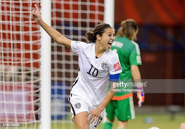 Carli Lloyd of the United States celebrates after assisting on the goal by Kelley O'Hara in the second half against Germany in the FIFA Women's World...
