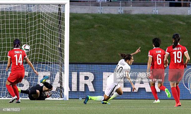 Carli Lloyd of the United States celebrates as she heads the ball past goalkeeper Wang Fei of China in the second half for her team's first goal in...