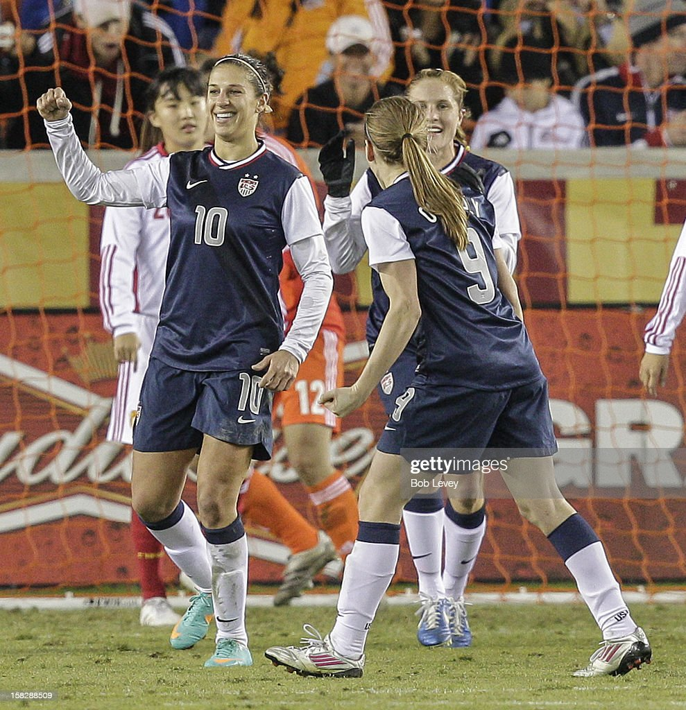 <a gi-track='captionPersonalityLinkClicked' href=/galleries/search?phrase=Carli+Lloyd&family=editorial&specificpeople=736799 ng-click='$event.stopPropagation()'>Carli Lloyd</a> #10 of the United States celebrates her score with <a gi-track='captionPersonalityLinkClicked' href=/galleries/search?phrase=Heather+O%27Reilly&family=editorial&specificpeople=736752 ng-click='$event.stopPropagation()'>Heather O'Reilly</a> #9 as dejected China team looks on in the second half at BBVA Compass Stadium on December 12, 2012 in Houston, Texas. USA won 4-0.