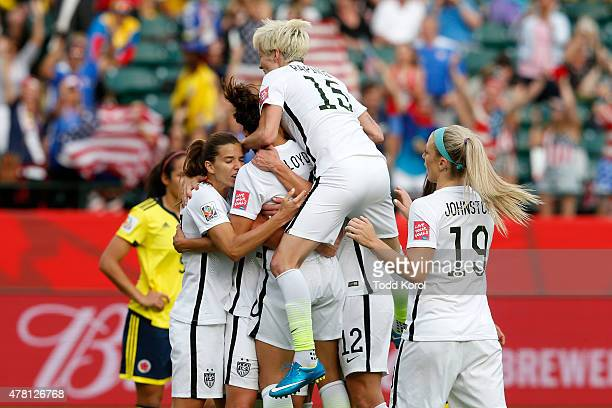 Carli Lloyd of the United States celebrates with teammates after scoring a goal on a penalty kick in the second half against Colombia in the FIFA...