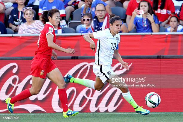 Carli Lloyd of the United States controls the ball against Wu Haiyan of China in the first half in the FIFA Women's World Cup 2015 Quarter Final...