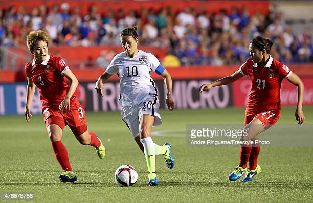 Carli Lloyd of the United States controls the ball in the second half against Pang Fengyue and Wang Lisi of China in the FIFA Women's World Cup 2015...