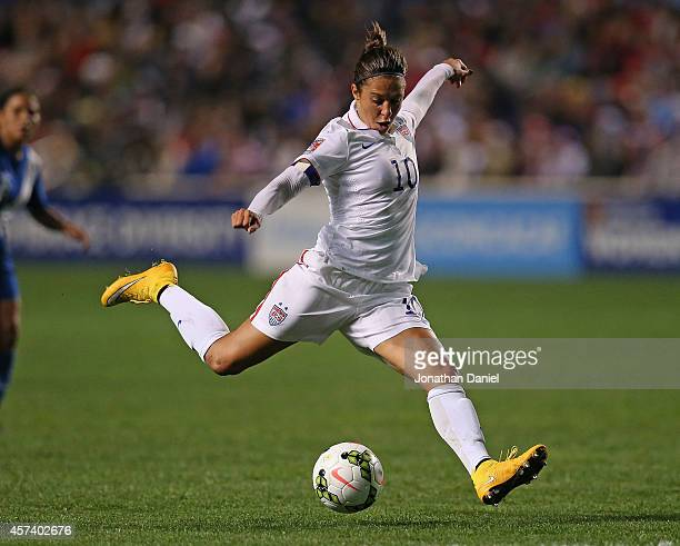 Carli Lloyd of the United States fires a shot against Guatemala during the 2014 CONCACAF Women's Championship at Toyota Park on October 17 2014 in...