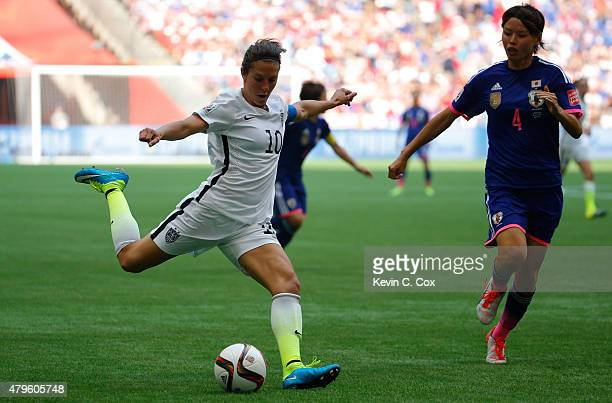 Carli Lloyd of the United States kicks the ball against Saki Kumagai of Japan in the second half in the FIFA Women's World Cup Canada 2015 Final at...