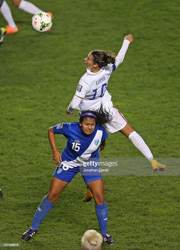 Carli Lloyd #10 of the United States leaps for the ball over Christian Recinos #15 of Guatemala during the 2014 CONCACAF Women's Championship at Toyota Park on October 17, 2014 in Bridgeview, Illinois. The United States defeated Guatemala 5-0.