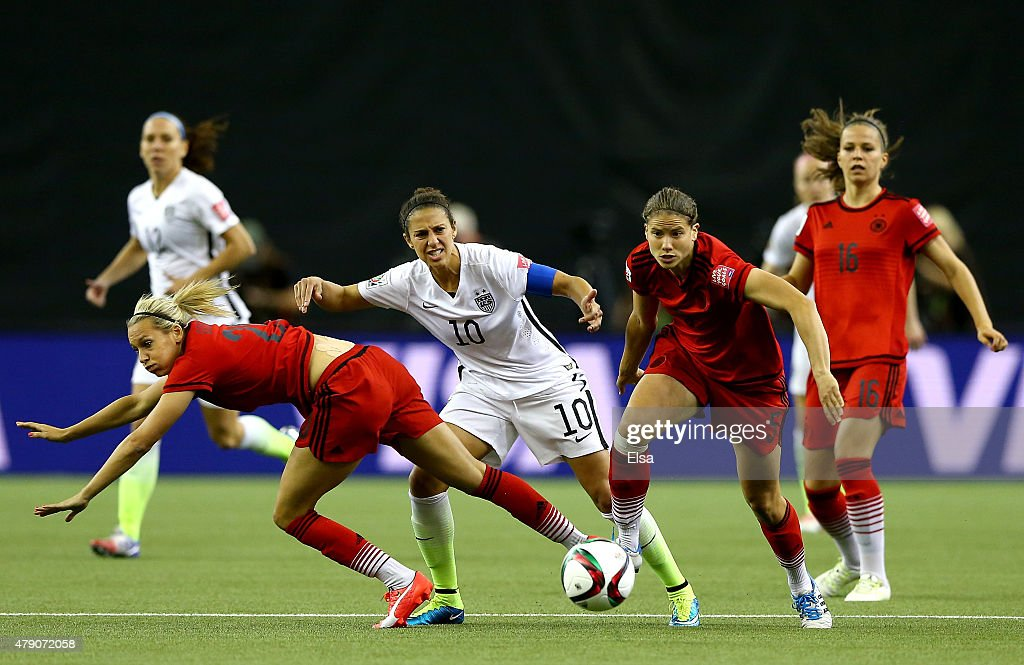 Carli Lloyd of the United States moves the ball between Lena Goessling and Annike Krahn of Germany in the first half in the FIFA Women's World Cup...