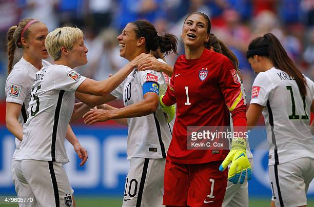 Carli Lloyd of the United States of America celebrates after her third goal against Japan with goalkeeper Hope Solo and Megan Rapinoe in the FIFA...