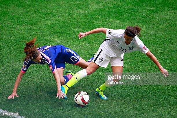 Carli Lloyd of the United States of America controls the ball against Rumi Utsugi of Japan in the FIFA Women's World Cup Canada 2015 Final at BC...