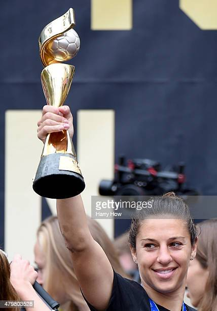 Carli Lloyd of the United States of America holds up the trophy in celebration of the 2015 Women's World Cup during a rally at LA Live on July 7 2015...