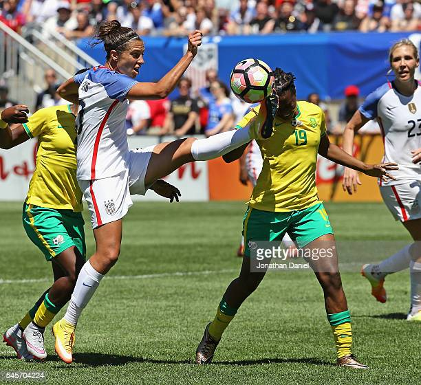 Carli Lloyd of the United States tries to get off a shot against Bambanani Mbane of South Africa during a friendly match at Soldier Field on July 9...