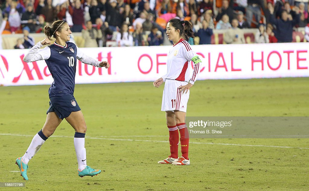 Carli Lloyd #10 of the U.S. Women's National Team celebrates her goal against the China Women's National Team in an international friendly game at BBVA Compass Stadium on December 12, 2012 in Houston, Texas. USA won 4 to 0.