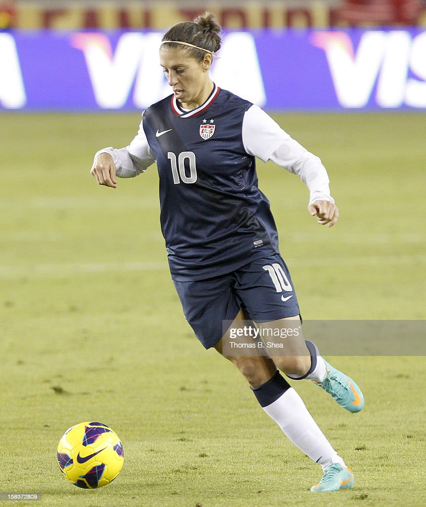 Carli Lloyd #10 of the U.S. Women's National Team dribbles the ball against the China Women's National Team in an international friendly game at BBVA Compass Stadium on December 12, 2012 in Houston, Texas. USA won 4 to 0.