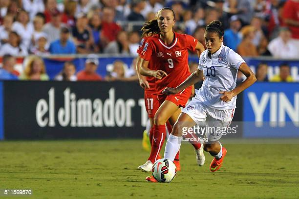 Carli Lloyd of the US women's national team in action against Lia Walti of the Swiss women's national team at WakeMed Soccer Park on August 20 2014...