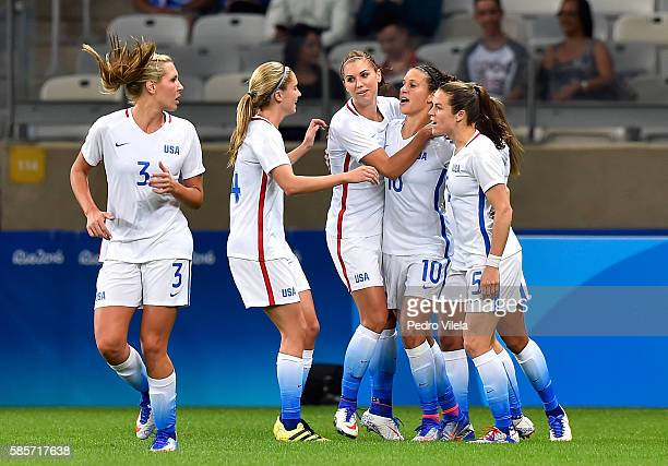 Carli Lloyd of United States celebrates after scoring in the first half in the Women's Group G first round match between the United States and New...