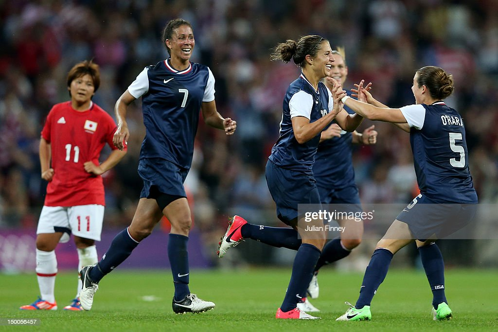 Carli Lloyd #10 of United States celebrates with Kelley O'Hara #5 and Shannon Boxx #7 after scoring in the second half against Japan during the Women's Football gold medal match on Day 13 of the London 2012 Olympic Games at Wembley Stadium on August 9, 2012 in London, England.