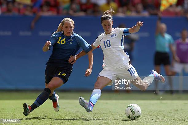 Carli Lloyd of United States passes the ball against Elin Rubensson of Sweden in the first half during the Women's Football Quarterfinal match at...