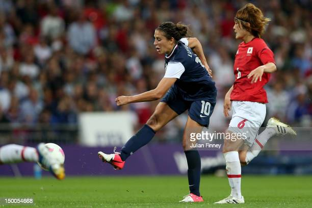 Carli Lloyd of United States scores a goal in the second half against Mizuho Sakaguchi of Japan during the Women's Football gold medal match on Day...