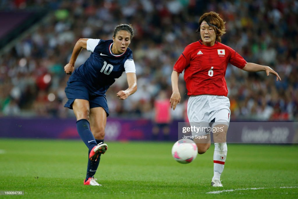 Carli Lloyd #10 of United States scores a goal in the second half against Mizuho Sakaguchi #6 of Japan during the Women's Football gold medal match on Day 13 of the London 2012 Olympic Games at Wembley Stadium on August 9, 2012 in London, England.