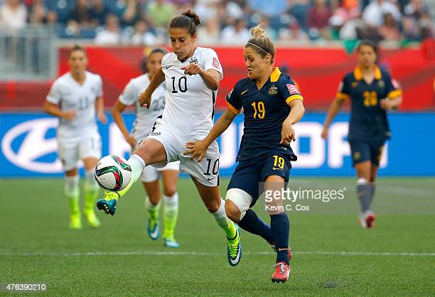 Carli Lloyd of United States with the ball against Katrina Gorry of Australia in the second half during the FIFA Women's World Cup 2015 Group D match...