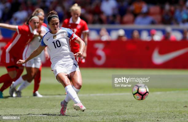 Carli Lloyd of US scores on a penalty kick in the first half against Russia during the International Friendly soccer match at BBVA Compass Stadium on...