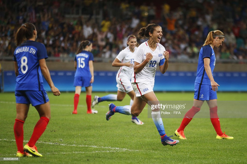 Carli Lloyd (M) of USA celebrates after scoring her team's firts goal during Women's Group G match between USA and France on Day 1 of the Rio2016 Olympic Games at Mineirao Stadium on August 6, 2016 in Belo Horizonte, Brazil.