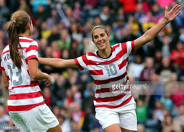 Carli Lloyd of USA celebrates with teammate Alex Morgan after scoring their third goal during the Women's Football first round Group G match between...