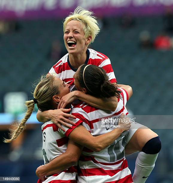 Carli Lloyd of USA celebrates with teammates Megan Rapinoe and Heather Mitts after scoring their third goal during the Women's Football first round...