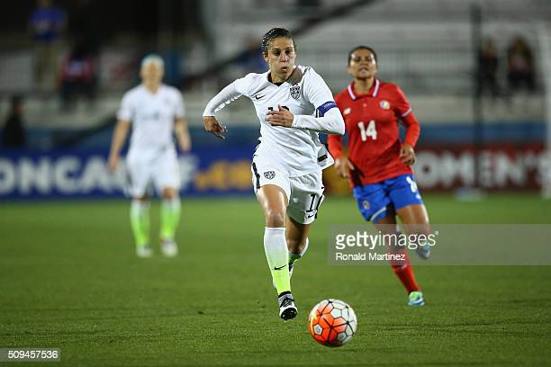 Carli Lloyd of USA dribbles the ball against Costa Rica during the 2016 CONCACAF Women's Olympic Qualifying at Toyota Stadium on February 10 2016 in...