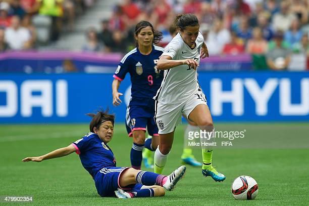 Carli Lloyd of USA gets past Aya Miyama of Japan during FIFA Women's World Cup 2015 Final between USA and Japan at BC Place Stadium on July 5 2015 in...