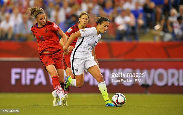 Carli Lloyd of USA is challenged by Melanie Leupolz of Germany during the FIFA Women's World Cup Semi Final match between USA and Germany at Olympic...