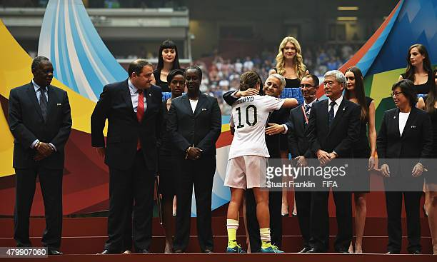 Carli Lloyd of USA is embraced by Sunil Gulati of the FIFA Executive Committee during the FIFA Women's World Cup Final between USA and Japan at BC...