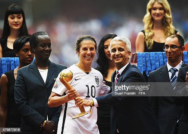 Carli Lloyd of USA is presented with the Adidas Golden ball award by Sunil Gulati of the FIFA Executive Committee during the FIFA Women's World Cup...